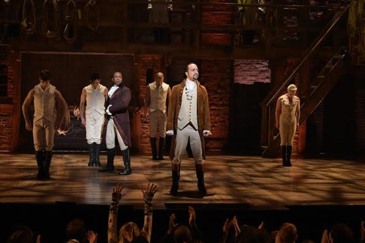 """NEW YORK, NY - FEBRUARY 15: Actor Leslie Odom, Jr. (L) and actor, composer Lin-Manuel Miranda (R) perform on stage during """"Hamilton"""" GRAMMY performance for The 58th GRAMMY Awards at Richard Rodgers Theater on February 15, 2016 in New York City. (Photo by Theo Wargo/Getty Images)"""