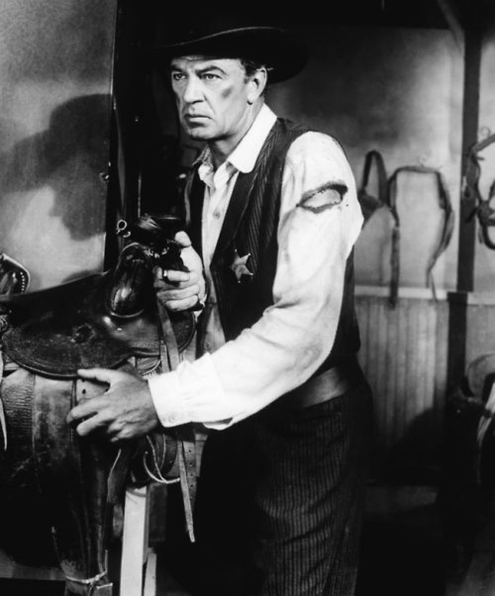 Gary Cooper as Marshal Will Kane in the United Artists' 1952 classic High Noon, written by John W. Cunningham (story) and Carl Foreman.