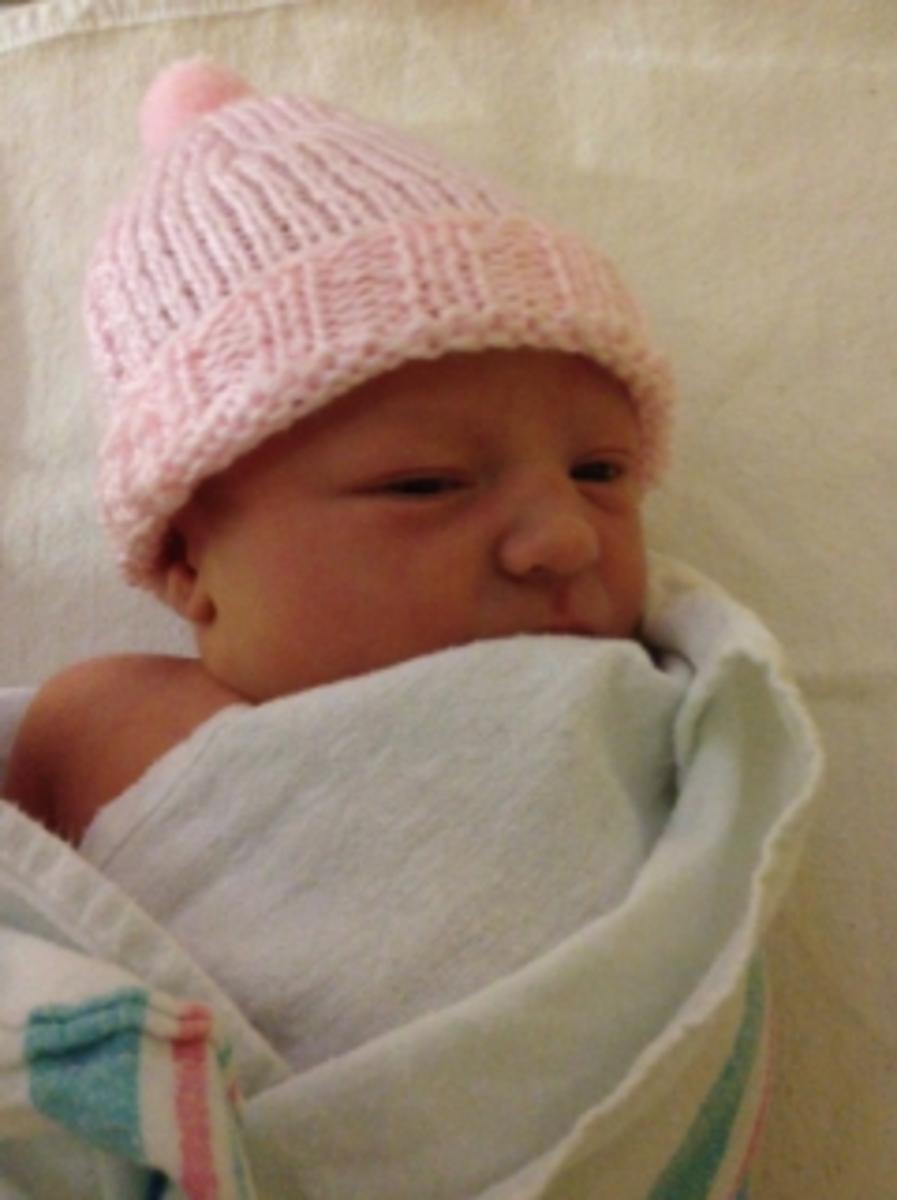 Geneva in her first few days -- rocking her cool hat.